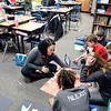 John P. Cleary | The Herald Bulletin <br /> Daleville Elementary School social worker Amber Fox will drop into classrooms throughout the day to checkup and to see students. Her she talks with fifth-grade students in David Hubble's class as they work on an assignment.