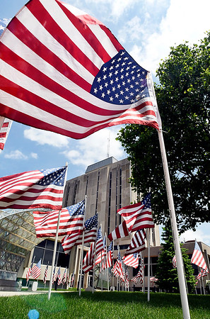 John P. Cleary   The Herald Bulletin <br /> Dozens of American flags wave in the breeze on the lawn of the Anderson City Building on Memorial Day as the Exchange Club of Anderson put up their display of American flags for the Memorial Day holiday weekend.