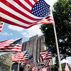 John P. Cleary | The Herald Bulletin <br /> Dozens of American flags wave in the breeze on the lawn of the Anderson City Building on Memorial Day as the Exchange Club of Anderson put up their display of American flags for the Memorial Day holiday weekend.
