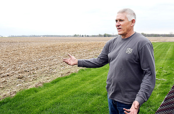 John P. Cleary | The Herald Bulletin <br /> Curt Harrison looks out over the field just to the north of his home that would be part of the proposed solar farm in northern Madison County.