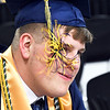 John P. Cleary | The Herald Bulletin <br /> Shenandoah High School senior Nathan Brummett blows the tassel from his graduation cap out of his face as he waits Thursday to get his official graduation photograph taken at the school.