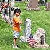 John P. Cleary | The Herald Bulletin <br /> This young man stops and says a prayer at this grave site as his family made a visit to Mapewood Cemetery Monday afternoon.