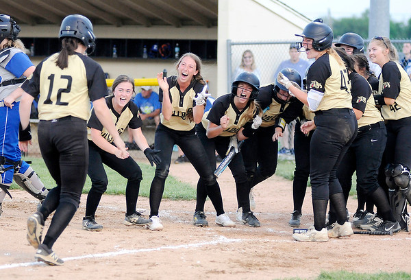 Don Knight   The Herald Bulletin<br /> The Bulldogs celebrate Ashlynn Allman's grand slam to tie the game in the bottom of the seventh in the regional against Tipton on Tuesday.