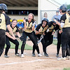 Don Knight | The Herald Bulletin<br /> The Bulldogs celebrate Ashlynn Allman's grand slam to tie the game in the bottom of the seventh in the regional against Tipton on Tuesday.