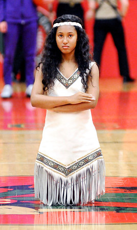 Don Knight | The Herald Bulletin<br /> Anderson High School Maiden Paige McKnight kneels at center court before the Anderson vs Marion basketball game.