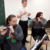 John P. Cleary | The Herald Bulletin <br /> Anderson High School marching band director Richard Geisler listens as Abbie Easterly and Roz Wood play their fifes during practice.