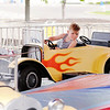 Don Knight | The Herald Bulletin<br /> Kage Gullion, 4, from Frankton rides a hot rod carousel during the Little 500 Festival Fair at the Applewood Center on Wednesday.  The festival will be open 5 to 11 p.m. on Friday, 3 to 11 p.m. on Saturday and 3 to 10 p.m. on Sunday. Wristbands are $20 and the festival is located in front of the former Target location.