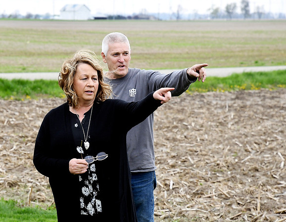 John P. Cleary | The Herald Bulletin <br /> Becky and Curt Harrison point out the area of the proposed solar farm that would come up to their property along CR450 N.