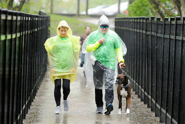 Don Knight | The Herald Bulletin<br /> Mike and Lynn Murray walk their boxer Reggie in the Madison County Humane Society Dog Walk-A-Thon at Shadyside Park on Saturday.