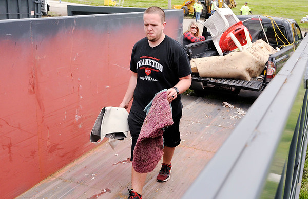 Don Knight | The Herald Bulletin<br /> Jacob Foklner unloads his truck at Athletic Park during the Annual Rev. J.T. Menifee citywide cleanup on Saturday.