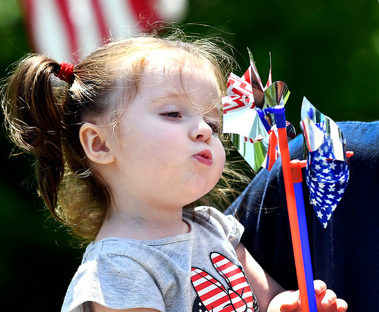John P. Cleary   The Herald Bulletin <br /> Two year-old Henzlie McVay has fun playing with, and blowing on, the patriotic pin wheels she received from Maplewood Cemetery Monday when her family visited the facility.