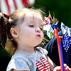 John P. Cleary | The Herald Bulletin <br /> Two year-old Henzlie McVay has fun playing with, and blowing on, the patriotic pin wheels she received from Maplewood Cemetery Monday when her family visited the facility.