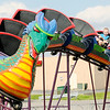 Don Knight | The Herald Bulletin<br /> From left, Korbin and Zane Tutrow ride the dragon roller coaster during the Little 500 Festival Fair at the Applewood Center on Wednesday. The festival will be open 5 to 11 p.m. on Friday, 3 to 11 p.m. on Saturday and 3 to 10 p.m. on Sunday. Wristbands are $20 and the festival is located in front of the former Target location.