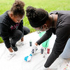 Don Knight | The Herald Bulletin<br /> Deborah Gardner, right, helps Sanae Turner tie dye a T-shirt during a meeting of the  Edge Club at Edgewood Elementary on Friday.