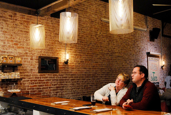 Don Knight | The Herald Bulletin<br /> From left, Nancy McGuire and Cameron Fields look at the menu at Pax Verum Brewing in Lapel on Saturday.