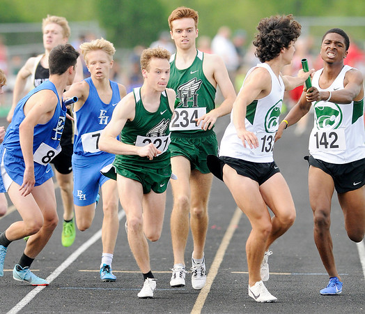 Don Knight | The Herald Bulletin<br /> Pendleton Heights Milan Jones takes the baton from Jayden Wenning as the Arabians start the third leg of the 4x800 meter relay during the boys track sectional at Mt. Vernon on Friday.