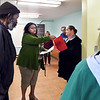 John P. Cleary | The Herald Bulletin <br /> Anderson Housing Authority's Public Housing Manager Mary Davis shows Westvale Manor residents the new laundry facilities Monday as she explains the features and hours of use to them.