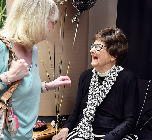 John P. Cleary | The Herald Bulletin <br /> Eulala Roettger, right, greets well wishers during her 100th birthday party  at the St. Vincent Erskine Building Thursday. Eulala is the oldest volunteer at the hospital, volunteering for the last 20 years, so the hospital gave her a party on her special day.