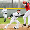Don Knight | The Herald Bulletin<br /> Pendleton Heights' Wyatt Douglas tags New Palestine's Noah Mack out as he was caught in a pickle after a failed attempt to steal second base on Friday.
