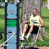 John P. Cleary | The Herald Bulletin <br /> Daniel Baxter works out on the rowing machine along the Jackson Park fitness trail Monday afternoon in Jackson Park. Baxter said  he came out along the fitness trail because his normal gym was closed today.