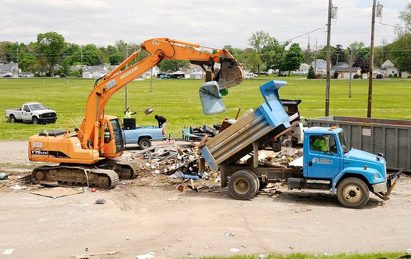 Don Knight | The Herald Bulletin<br /> A city dump truck unloads at Athletic Park during the Annual Rev. J.T. Menifee citywide cleanup on Saturday. City workers picked up large items from residents that were unable to haul them to the park.