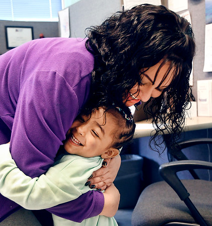 John P. Cleary | The Herald Bulletin <br /> Children at Gateway daycare talk about their mothers for a Mother's Day feature. Here three-year old Brookylnn Thurman gives her mother, Tykayla Bond, a hug as they say goodbye as she drops Brookylnn off at Gateway.