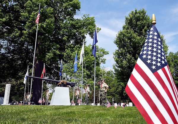 John P. Cleary | The Herald Bulletin <br /> Members of Boy Scout Troop 301 raise the colors of each of the six branches of the service during the annual Memorial Day services at Maplewood Cemetery Monday.