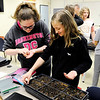 Don Knight | The Herald Bulletin<br /> From left, Sophia Kramer and Malia Lusby plant tomato seeds at Shenandoah Middle School on Thursday. The group 'Doah Growers is growing vegetables to donate to a food bank.