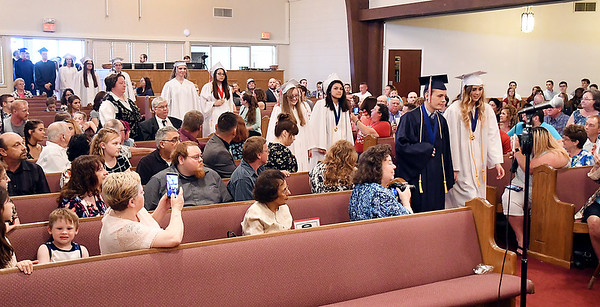 John P. Cleary   The Herald Bulletin <br /> The 12 members of the 2019 graduating class of Indiana Christian Academy<br /> proceed into the sanctuary of Grace Baptist Church for their graduation ceremony.