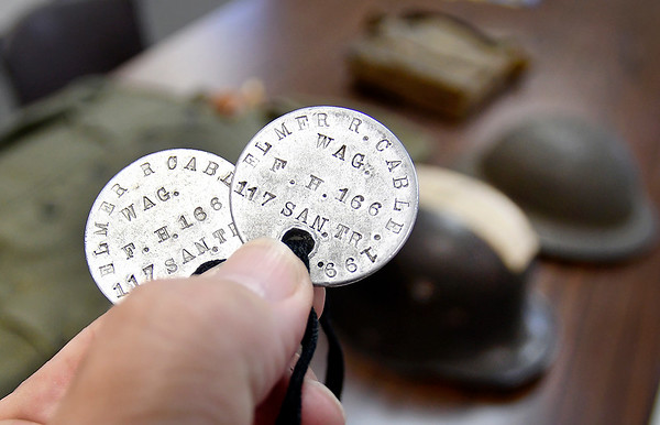 John P. Cleary | The Herald Bulletin <br /> Veterans Affairs officer Bruce Dunham talks about his grandfathers WW I experiences. Elmer Cable's dog tags were circular, not oblong, with his service number,199, stamped around the edge.