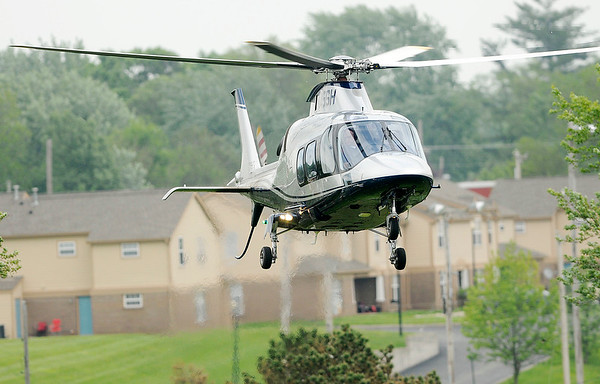 Don Knight | The Herald Bulletin<br /> Chris Windom arrives by helicopter at the Anderson Speedway on Thursday to qualify the car for the Anderson based Goucher Racing team for the Little 500 after qualifying tenth for the IndyLights race at Indianapolis Motor Speedway.