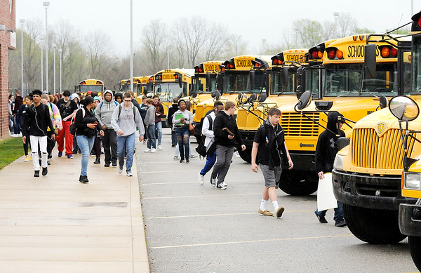"Don Knight | The Herald Bulletin<br /> Students leave Anderson High School at the end of the school day on Thursday. the American Academy of Pediatrics has recommended that middle and high schools delay start times to 8:30 a.m. or later to ""align school schedules to the biological sleep rhythms of adolescents, whose sleep-wake cycles begin to shift up to two hours later at the start of puberty."""