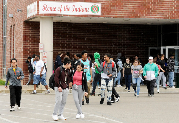 Don Knight | The Herald Bulletin<br /> Students leave Anderson High School at the end of the school day on Thursday. The school day starts at 7:30 a.m. for Anderson and Highland students.