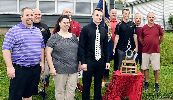 Cade Vernetti, center, of Alexandria-Monroe High School was named the 2020 Red Haven Memorial Award winner. Cade is surrounded by his parents, Greg & Drnnae Vernetti, front left, and his Alexandria coaches and staff members during the award presentation Tuesday.