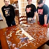 The King family still likes to work puzzles during their stay-at-home time, here Connor, 14, Phil, and Cooper,12,  look over their latest endeavor which Phil says is the hardest one so far.
