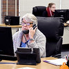 Madison County treasurer's office staffers Karen Beechboard and Harmeney Blackford answer taxpayers questions as they work to process the spring property tax payments.