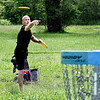 Mike Dubois lets his second shot fly toward the basket on the first hole of the Sanders Memorial Disc Golf Course at Edgewater Park Monday afternoon enjoying the warm holiday weather. The city just reopened the course this past Saturday after being shut down for more then two months due to the coronavirus pandemic.