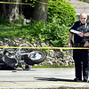 Anderson Police Department investigators confer as they investigate a  accident involving a motorcycle Friday afternoon in the 3400 block of South Scatterfield Road. Madison County Coroner Danielle Dunnichay-Noone confirmed there was one fatality as a result from the accident.