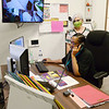 Rene Fuller talks on the phone as Johna Lee looks on at Alternatives on Friday. Figures for emergency dispatch services in April showed there was a 12.3% increase in domestic violence calls as compared to a year ago.