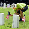 James Pugh takes a photo of a head stone his was looking for as he visits Maplewood Cemetery on Memorial Day.