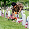 Ceatrice Bostic places flowers on her brother's grave in the veterans section of Maplewood Cemetery Monday. Bostic visits the gravesite of her brother Donald Nunn, a Vietnam veteran, every Memorial Day.