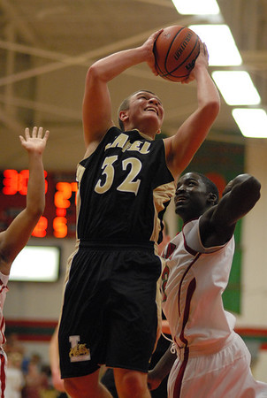 Lapel sophomore Brad Cherry goes in for a lay up during the first half of the Bulldogs game against Anderson High School.
