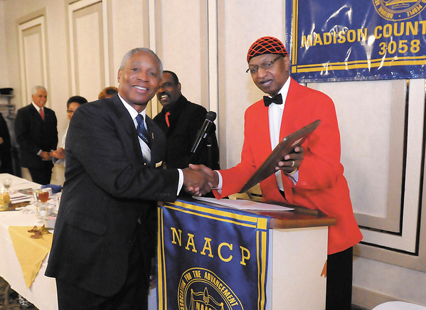 Charles Walker accepts the Presidents Award from Madison County NAACP President James Burgess during the B. Harry Beckham Freedom Fund Banquet on Saturday.