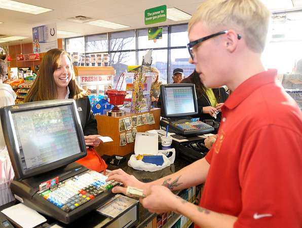 Denise Fosnaugh buys Powerball tickets for the first time from cashier Kyle Houdek at the Ninth Street Ricker's on Wednesday. Powerball tickets sales were brisk at the Ninth Street Ricker's as the jackpot increased to $550 million ahead of Wednesday night's drawing.