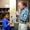 Quinlyn Byrd asks her teacher Doug Beisley a question about her homework  at Liberty Christian on Thursday.