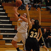 Desirae Litchfield puts two points on the scoreboard for the Alexandria Tigers.