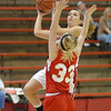 Frankton senior Kelsey Key keeps her eye on the basket while driving through the foul lane.