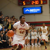 Tim Boyd brings the ball down court for the Indians.