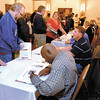 Athletes that appeared in the 100 Greatest Athletes book lined up to sign the books for the public at a reception and book signing Tuesday evening at the Anderson Center for the Arts.
