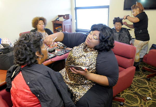 "Talisa ""Tally"" Anderson applies makeup to Oleta Martin-McClurkin as Tonee Nevings styles Oraphine Stovall's hair before their photo shoot at the Best Western in Anderson on Saturday."